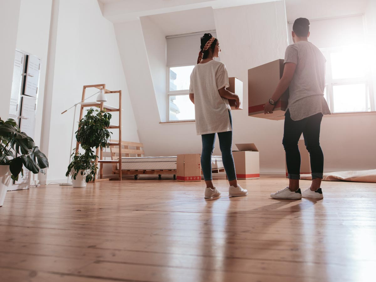 Young couple moving into their first home together.